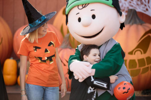 Spooky Farm Little Boy and Mom hugging Halloween Charlie Brown in front of pumpkins 2017